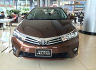 Cần bán xe Toyota Corolla Altis 1.8G (CVT) model 2018, màu nâu, giao xe ngay trong ngày, thủ tục nhanh gọn giá 718 triệu tại Hà Nội