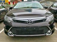 Cần bán xe Toyota Camry 2.0E đời 2017, màu nâu giá 947 triệu tại Hà Nội