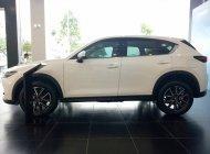 Cần bán xe CX-5 2.5L 2WD 2018 màu trắng, hỗ trợ vay 90%, xe giao ngay. Lh 0931886936 Thịnh Mazda giá 999 triệu tại Tp.HCM