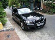 Bán BMW 3 Series 320i sản xuất năm 2010, màu đen, xe nhập giá 555 triệu tại Tp.HCM
