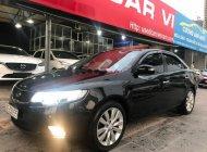 Cần bán Kia Cerato 1.6 AT sản xuất năm 2010, màu đen, nhập khẩu  giá 385 triệu tại Hà Nội