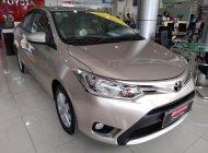 Bán xe Toyota Vios E 2016, màu vàng đồng, giá thương lượng, có hỗ trợ trả góp giá 500 triệu tại Tp.HCM