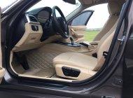 Bán gấp xe BMW 320i sản xuất 2012 màu nâu, xe nhập khẩu, chính chủ từ đầu giá 835 triệu tại Hà Nội