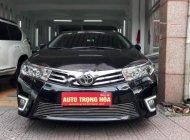 Chính chủ bán xe Toyota Corolla altis 1.8AT sản xuất 2016, màu đen giá 825 triệu tại Hà Nội