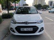 Cần bán Hyundai Grand i10 1.2 AT sản xuất năm 2015, màu trắng, xe nhập giá 392 triệu tại Hà Nội