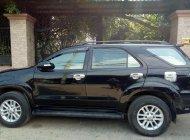 Cần bán Toyota Fortuner V năm 2013, màu đen giá 749 triệu tại Tp.HCM