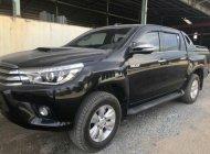 Bán Toyota Hilux năm 2016, màu đen, nhập khẩu giá 715 triệu tại Tp.HCM