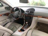 Cần bán Mercedes E200 đời 2004, màu kem (be), giá chỉ 320 triệu giá 320 triệu tại Tp.HCM