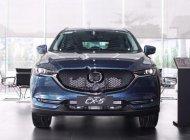 Cần bán Mazda CX 5 2.5 AT AWD 2018, màu xanh lam giá 1 tỷ 19 tr tại Tp.HCM