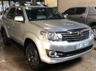 Cần bán Toyota Fortuner 2.7V 4x2 AT đời 2015, màu bạc giá 868 triệu tại Tp.HCM
