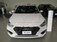 Cần bán xe Hyundai Accent 1.4 ATH 2018, màu trắng giá 550 triệu tại Tp.HCM