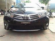 Cần bán Toyota Corolla altis 1.8G AT đời 2015, màu đen   giá 670 triệu tại Hà Nội