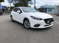 Bán Mazda 3 1.5 AT năm sản xuất 2015, màu trắng giá 616 triệu tại Tp.HCM