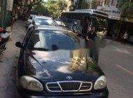 Cần bán gấp Daewoo Lanos năm sản xuất 2001, màu đen giá 52 triệu tại Hà Nội