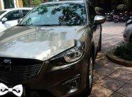 Chính chủ bán Mazda CX 5 năm sản xuất 2014, màu vàng cát giá 668 triệu tại Hà Nội