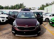 Bán xe Kia Rondo GAT, màu đỏ mận giá 669 triệu tại Tiền Giang