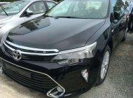 Cần bán Toyota Camry đời 2018, màu đen, giá tốt giá 900 triệu tại Tp.HCM