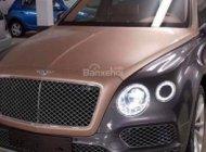 Bán xe Bentley Bentayga 4.0L sản xuất năm 2018, màu vàng cát và xám tôn, xe nhập Mỹ giá 16 tỷ 262 tr tại Hà Nội