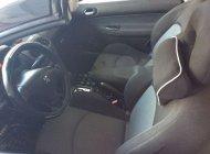 Cần bán Peugeot 206 đời 2006, màu đen, đăng ký lần đầu 2009 giá 500 triệu tại Tp.HCM