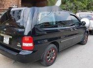 Cần bán lại xe Kia Carnival đời 2009, màu đen xe gia đình, giá chỉ 280 triệu giá 280 triệu tại Tp.HCM