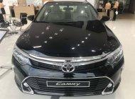 Bán ô tô Toyota Camry 2.0E đời 2018, màu đen giá 972 triệu tại Tp.HCM