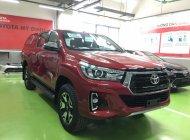 Bán xe Toyota Hilux 2.8L màu đỏ giao ngay giá 878 triệu tại Hà Nội