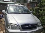 Cần bán Kia Carnival sản xuất năm 2006, màu bạc, nhập khẩu nguyên chiếc còn mới giá 240 triệu tại Tp.HCM