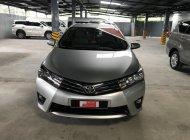 Cần bán xe Toyota Corolla altis 1.8G MT đời 2015, màu bạc giá 610 triệu tại Tp.HCM