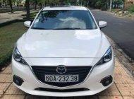 Cần bán xe Mazda 3 1.5AT sản xuất năm 2015, màu trắng, giá chỉ 595 triệu giá 595 triệu tại Đồng Nai