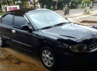 Cần bán lại xe Kia Spectra 2004, màu đen giá 115 triệu tại Lâm Đồng
