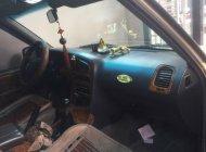Cần bán xe Ssangyong Musso đời 2003, màu vàng, nhập khẩu nguyên chiếc xe gia đình, 200tr giá 200 triệu tại Tp.HCM