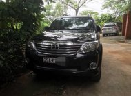 Cần bán xe Toyota Fortuner năm 2012, màu đen giá 650 triệu tại Hà Nội