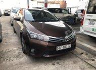Bán ô tô Toyota Corolla altis sản xuất 2015, màu nâu giá 665 triệu tại Tp.HCM
