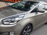 Bán Kia Rondo GAT 2.0 AT số tự động, model 2016, đời T12/2015, màu vàng cát mới 95% giá 559 triệu tại Tp.HCM