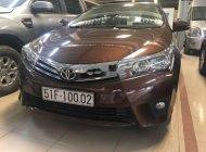 Cần bán Toyota Corolla Altis AT 2015 from mới, odo chuẩn 13000 km giá 665 triệu tại Tp.HCM