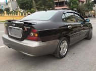 Nhà mình cần bán xe Daewoo Magnus 2.5AT L6 số tự động, màu đen zin giá 198 triệu tại Tp.HCM