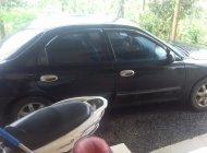 Cần bán Kia Spectra đời 2004, màu đen giá 115 triệu tại Lâm Đồng