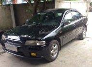 Ban xe Mazda 323 1999, màu đen giá 115 triệu tại Nghệ An