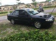 Cần bán xe Mazda 626 năm sản xuất 2002, màu đen, xe nhập giá 210 triệu tại Hà Nội
