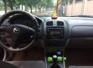 Cần bán xe Mazda 323 2004, màu đen xe gia đình, 190tr giá 190 triệu tại Nghệ An