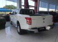 [TP. Hồ Chí Minh] bán Mitsubishi Triton 4x2 MT 2018, giá tốt, hỗ trợ cho vay 80% xe giá 556 triệu tại Tp.HCM