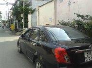 Bán ô tô Daewoo Lacetti sản xuất 2004, màu đen số sàn giá 125 triệu tại Tp.HCM