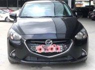 Cần bán lại xe Mazda 2 1.5 AT năm sản xuất 2016, màu đen số tự động, giá tốt giá 506 triệu tại Tp.HCM