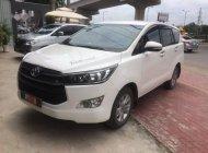 Bán xe Toyota Innova 2.0E, số sàn, sản xuất 2017, màu trắng, máy xăng giá 740 triệu tại Tp.HCM