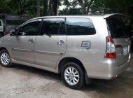 Cần bán Toyota Innova 2.0E đời 2014, màu bạc  giá 585 triệu tại Tp.HCM