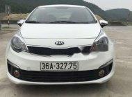 Cần bán gấp Kia Rio năm 2014, màu trắng, xe đang chạy bình thường giá 355 triệu tại Thanh Hóa