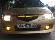 Cần bán xe Mazda Premacy 1.8 AT 2003, màu vàng giá 150 triệu tại Thanh Hóa