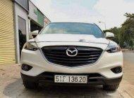 Bán ô tô cũ Mazda CX 9 sản xuất năm 2015, màu trắng giá 1 tỷ 380 tr tại Tp.HCM