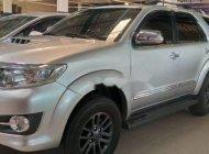 Bán Toyota Fortuner MT sản xuất năm 2014, màu bạc giá 825 triệu tại Tp.HCM