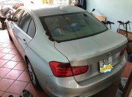Cần bán lại xe BMW 3 Series 320i sản xuất năm 2015, màu bạc, nhập khẩu  giá 990 triệu tại Tp.HCM